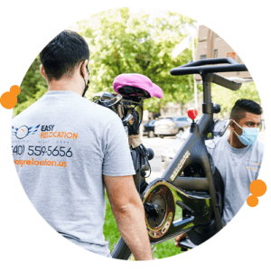 commercial movers loading exercise equipment