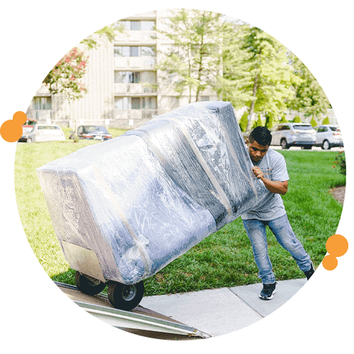 Professional mover pushing a large item up a ramp