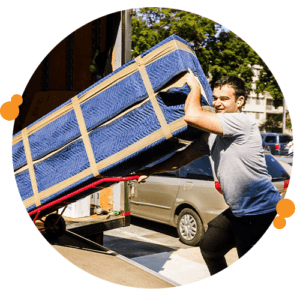 loading large items into the back of a moving truck using a ramp